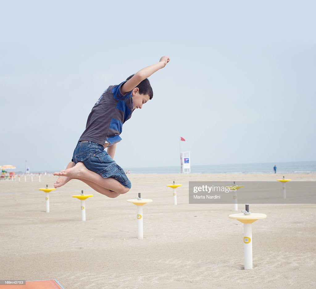 Boy jumping on a beach : Stock Photo