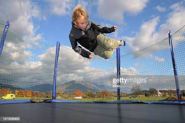 Boy Jumping on Trampoline