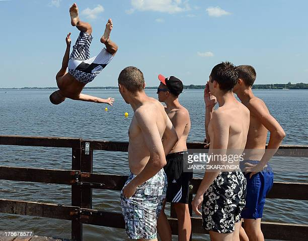 A boy jumps into the water at a forbidden place on Zegrze lake near Warsaw Poland on August 6 2013 Thirtyfive people have drowned in Poland since the...