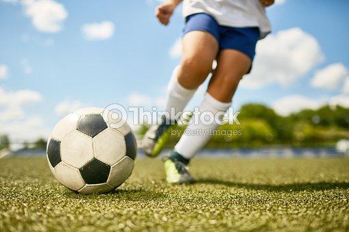 Boy Kicking Ball : Stock Photo
