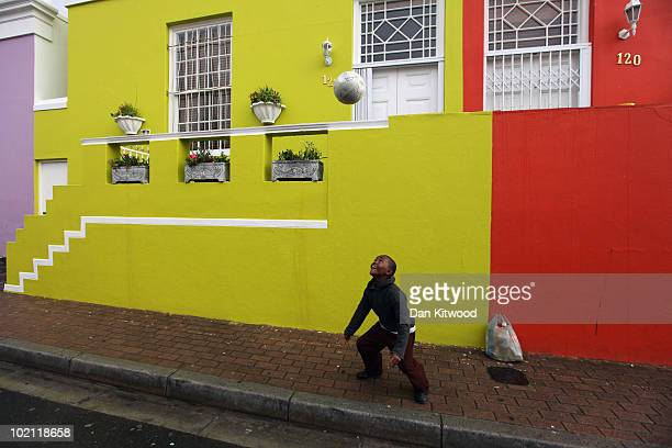 A boy Kicks a football down a street in the Bo Kaap area of Cape Town on June 15 2010 in Cape Town South Africa The excitement and passion of the...