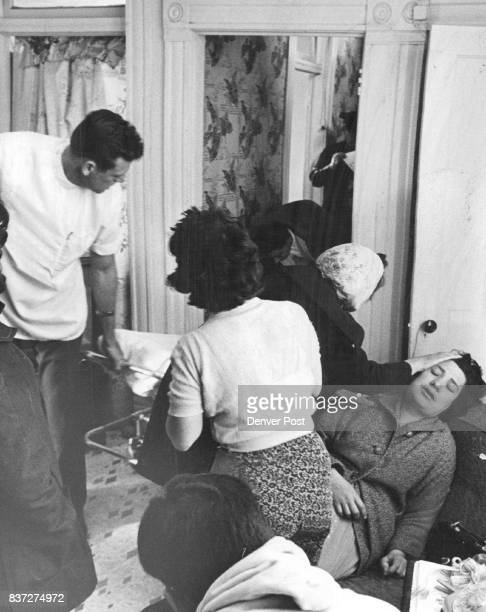 Boy Killed Playing With Revolver Mrs Margarito Jaramillo right is comforted by a friend as the body of her son Raymond is carried out by ambulance...
