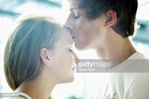 boy kisses forehead of his girlfriend : Stock Photo
