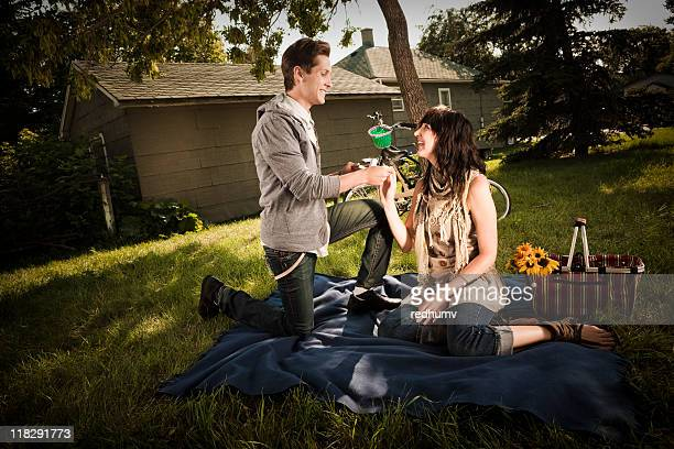 Boy kneeling and proposing to Girl