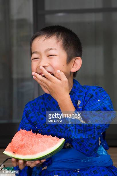 Boy Laughing and Holding Watermelon