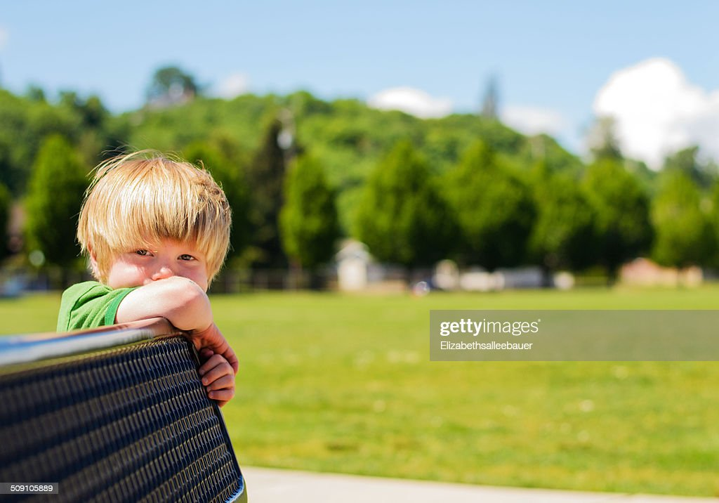 Boy leaning on bench (4-5 years)