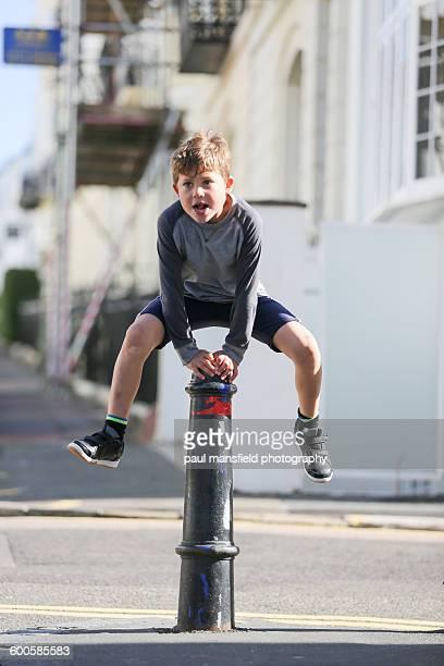 Boy leapfrogging post