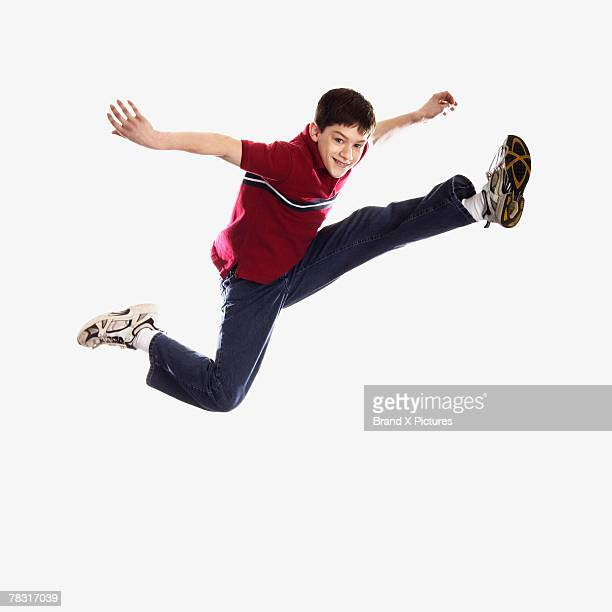Boy leaping in air
