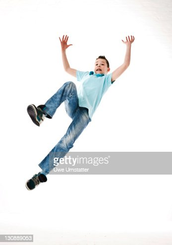 A boy leaping into the air