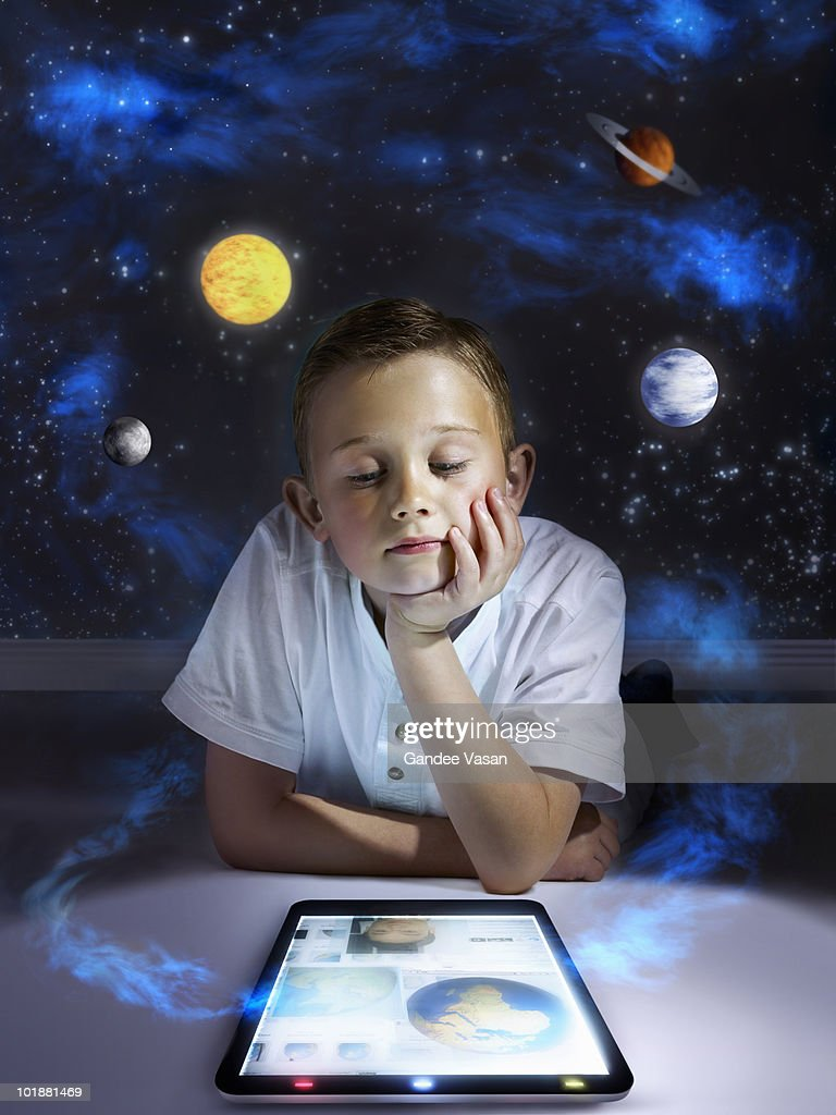 Boy learning from tablet computer : Bildbanksbilder