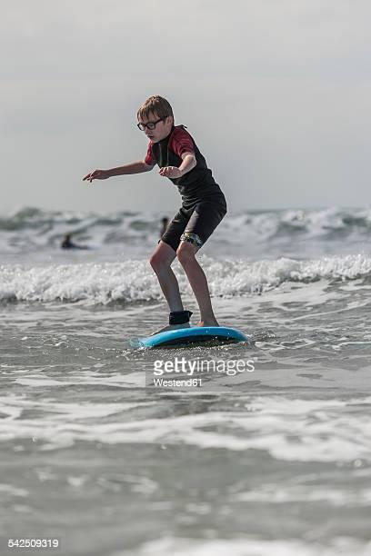 Boy learning surfboarding