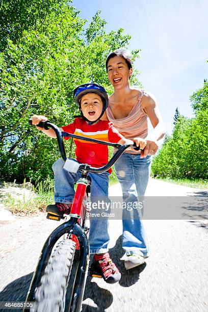 Boy learns to ride his peddle bike