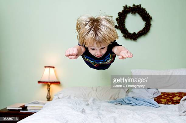 Boy Levitates on Bed