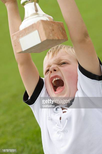 Boy lifting a trophy