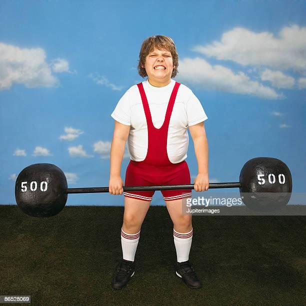 Boy lifting barbell