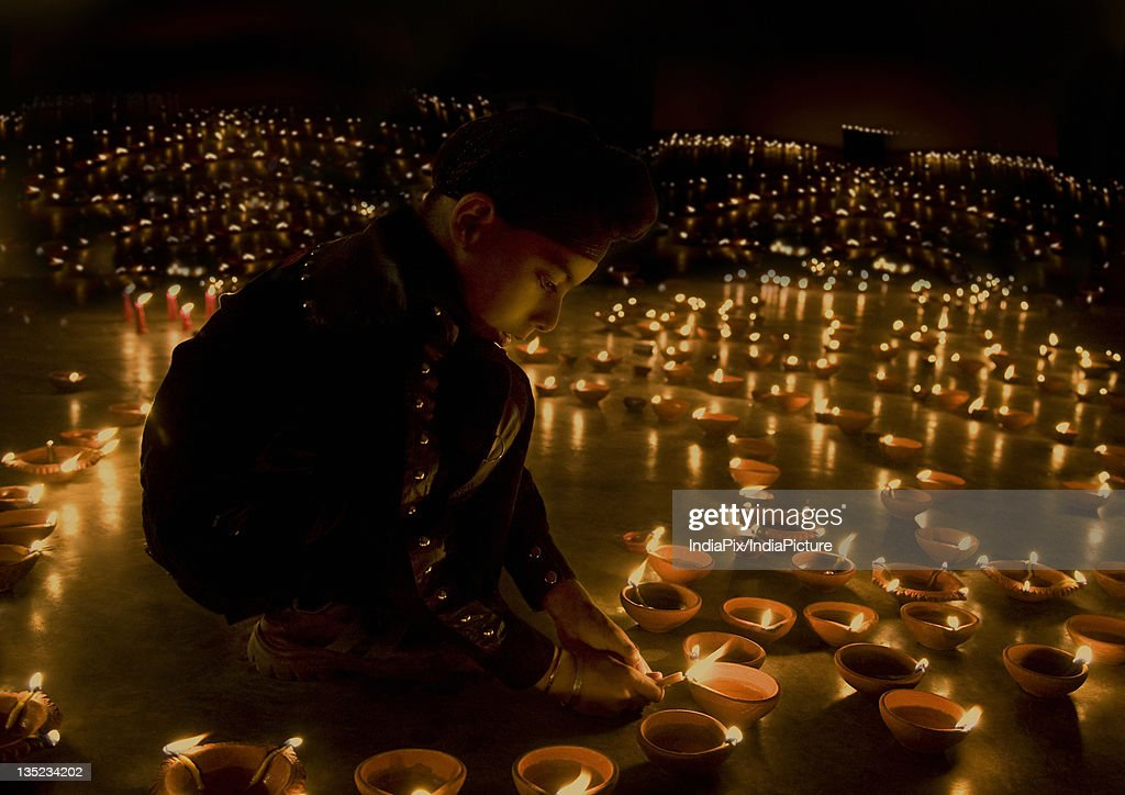 & A Boy Lighting Diyas Stock Photo | Getty Images azcodes.com
