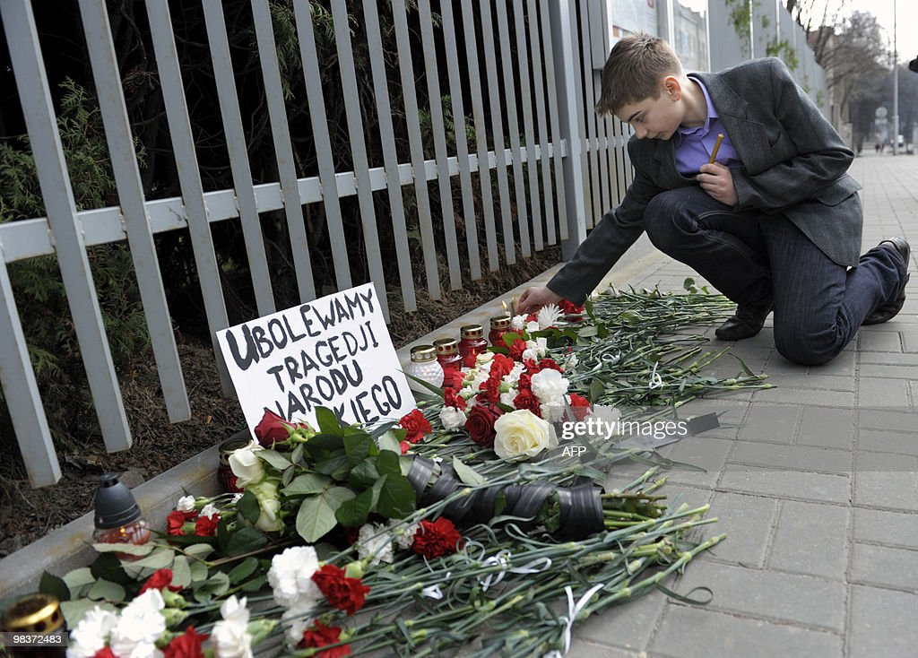 A boy lights a candle in front of the Polish embassy in Minsk after the crash of the Presidential plane in Smolensk on April 10 2010 Poland's Prime...