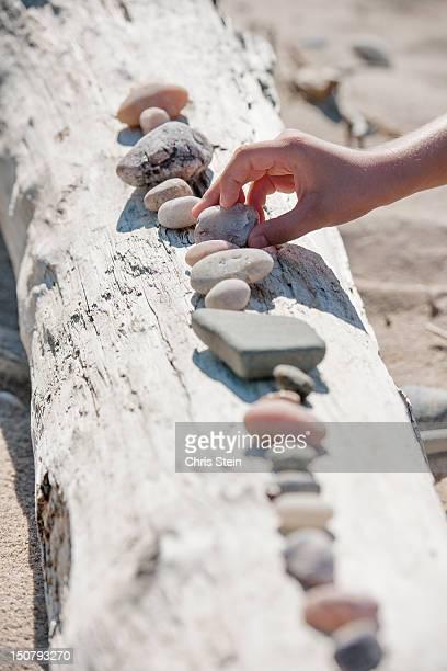Boy lining up rocks