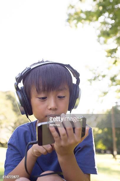 Boy listening to music on smart phone