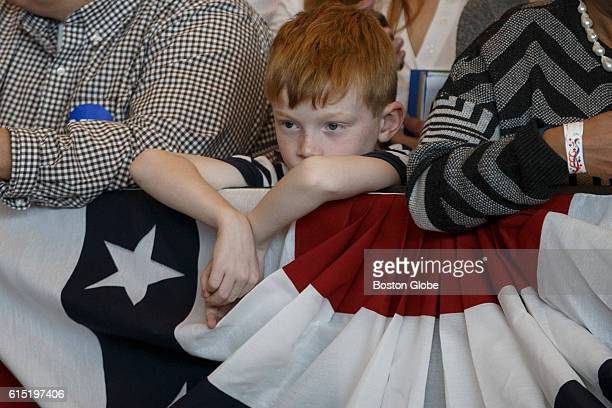 A boy listens as former US President Bill Clinton speaks on behalf of his wife Democratic presidential nominee Hillary Clinton during a campaign...