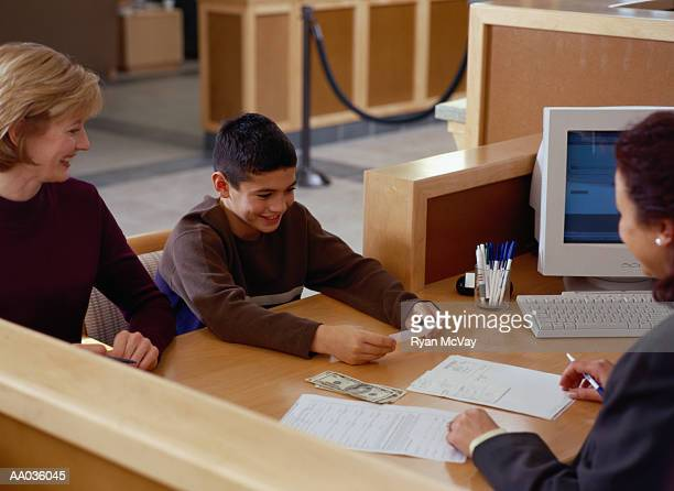 Boy Looking at a Bank Statement in a Bank