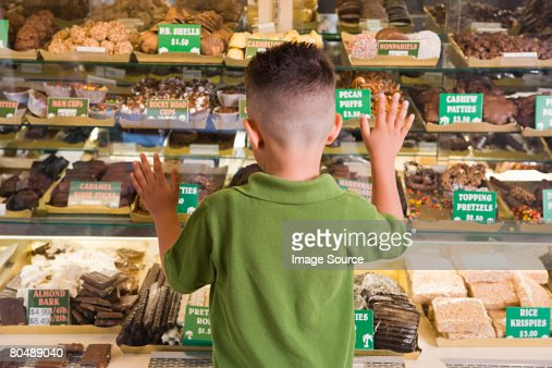 Boy looking at cakes