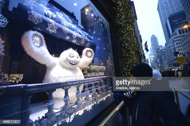 A boy looking at Christmas decoration in the shop at 5th Avenue in New York City on December 12 2013