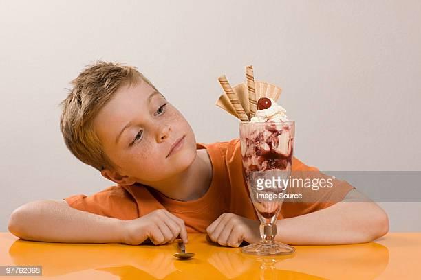 Boy looking at ice cream sundae