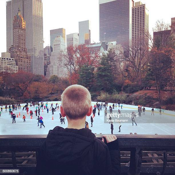 Boy Looking at ice skating rink in New York