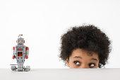 Boy looking at robot