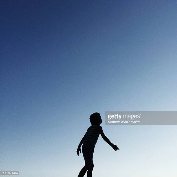 Boy looking at the sky