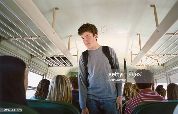 Boy Looking for Seat on Bus