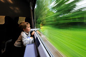 Boy looking out of train window