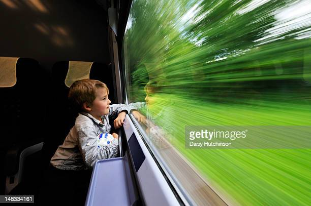 Boy looking out of train window