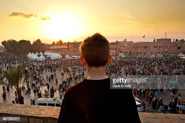 Boy looking out onto Crowded Square