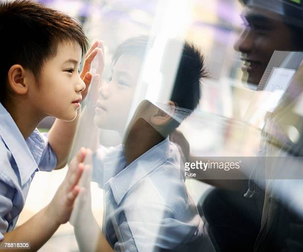 Boy Looking Through Shop Window