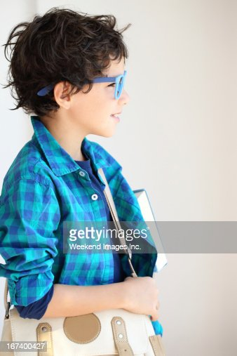 Boy looking to the window : Stock Photo