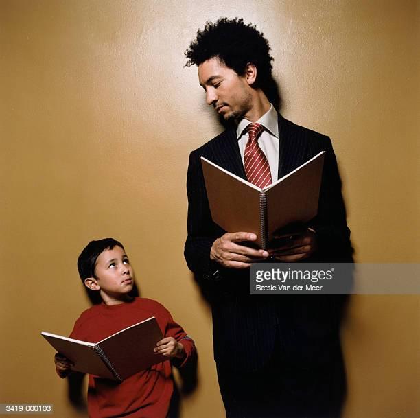 Boy Looking up at Teacher