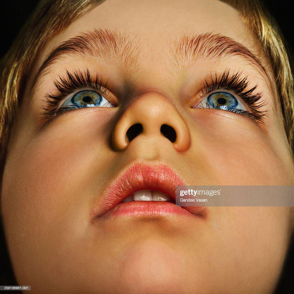 Boy (4-6) looking up, close up (Digital Enhancement) : Stock Photo