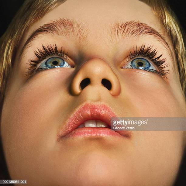 Boy (4-6) looking up, close up (Digital Enhancement)