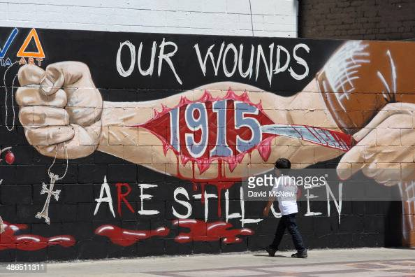 A boy looks at a mural commemorating the 1915 Armenian Genocide on Hollywood Boulevard near a rally on the 99th anniversary of the event calling for...