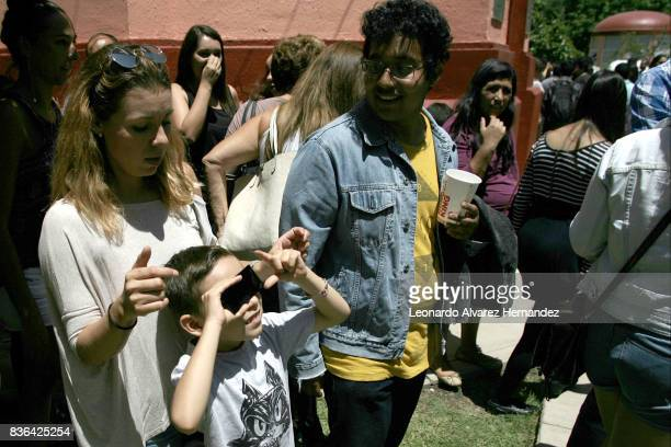 A boy looks at a partial solar eclipse in the Institute of Astronomy and Meteorology at Guadalajara University on August 21 2017 in Guadalajara México