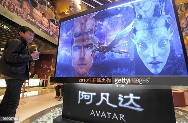 A boy looks at a poster for the movie 'Avatar' at a cinema in Beijing on January 21 2010 The Hollywood blockbuster 'Avatar' has become China's...