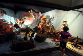 A boy looks at an underwater scene of mechanical toys inspired by French artist Albert Dubout at the Automaton museum in Souillac on July 10 2013 AFP...
