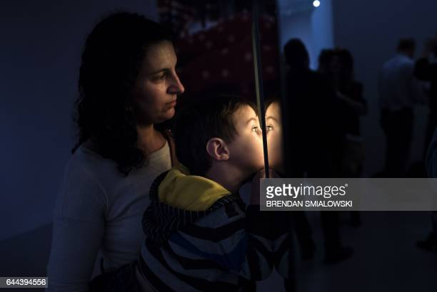 A boy looks into the Love Forever room during a preview of the Yayoi Kusama's Infinity Mirrors exhibit at the Hirshhorn Museum February 21 2017 in...