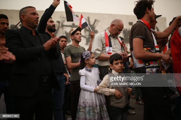 A boy looks on as hundreds of supporters of Iraqi cleric Moqtada Sadr and civil activists hold a protest on Tahrir Square in central Baghdad on April...
