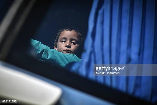 A boy looks on while riding in a bus bound for the northern Serbian city of Kanjiza close to the Hungarian border at Belgrade's main bus station on...
