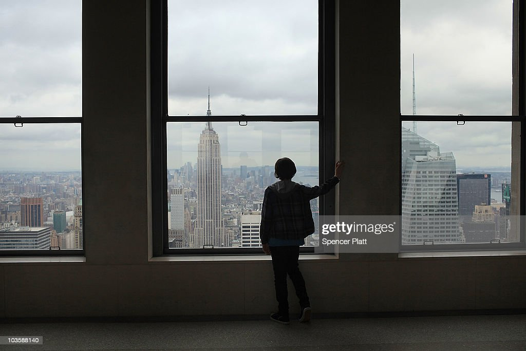 A boy looks out at the Empire State Building from the observation deck at Rockefeller Center on August 24, 2010 in New York City. A proposed tower on 34th Street would stand only 900 feet away from the iconic Empire State Building if it were to be completed. The new tower, which would be built at 15 Penn Plaza, has drawn criticism from the owners of the 102-storey Empire State Building, who say that at its current proposed height it would be just 34 feet shorter than the Empire State building and would severely alter the view of the Manhattan skyline. Standing at 1,250 feet at the 102nd floor, the Empire State building is currently the tallest building in New York.