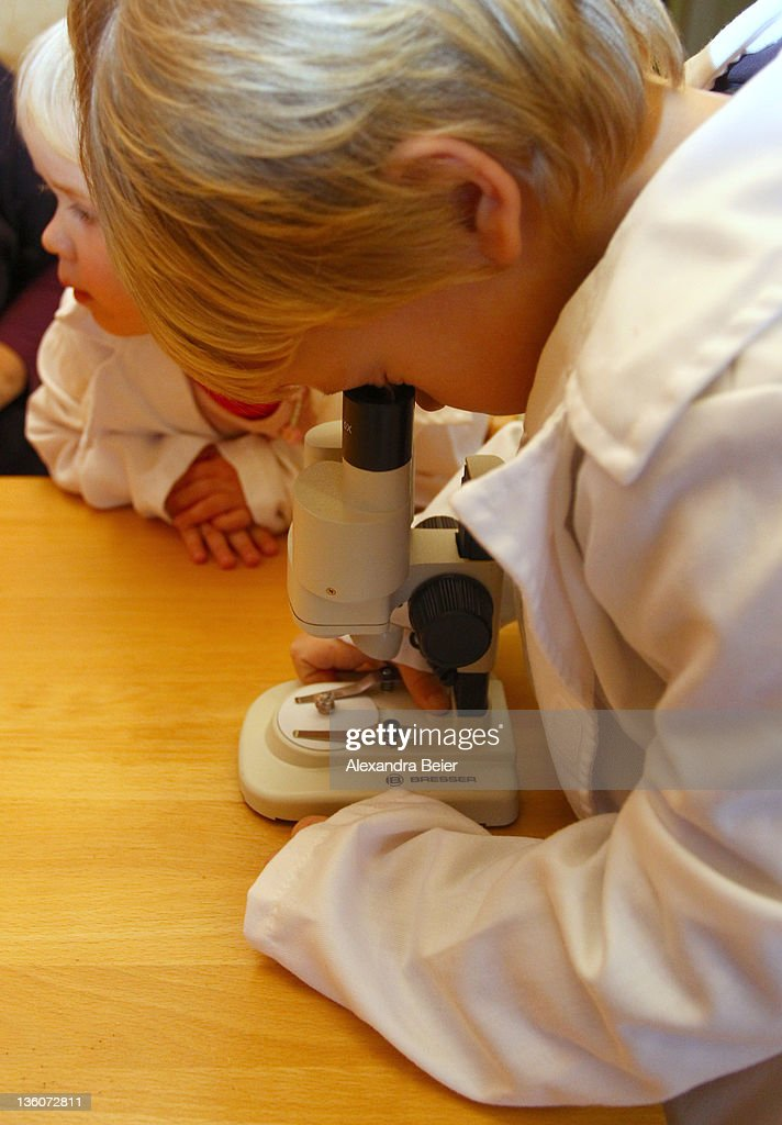 A boy looks through a microscope at a day care center for children aged 12 months to six years on December 22, 2011 in Munich, Germany. German authorities claim the country will need to increase the capacity of its child day care centers by at least an additional 230,000 by 2013.