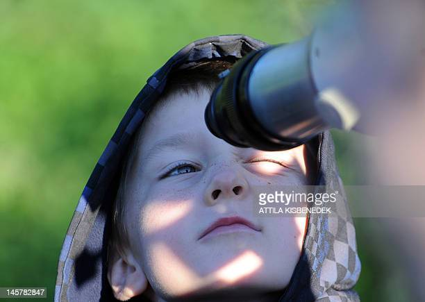 A boy looks through a telescope on June 6 2012 to see Venus transit across the Sun at the Obuda observatory in Budapest Skygazers around the world...